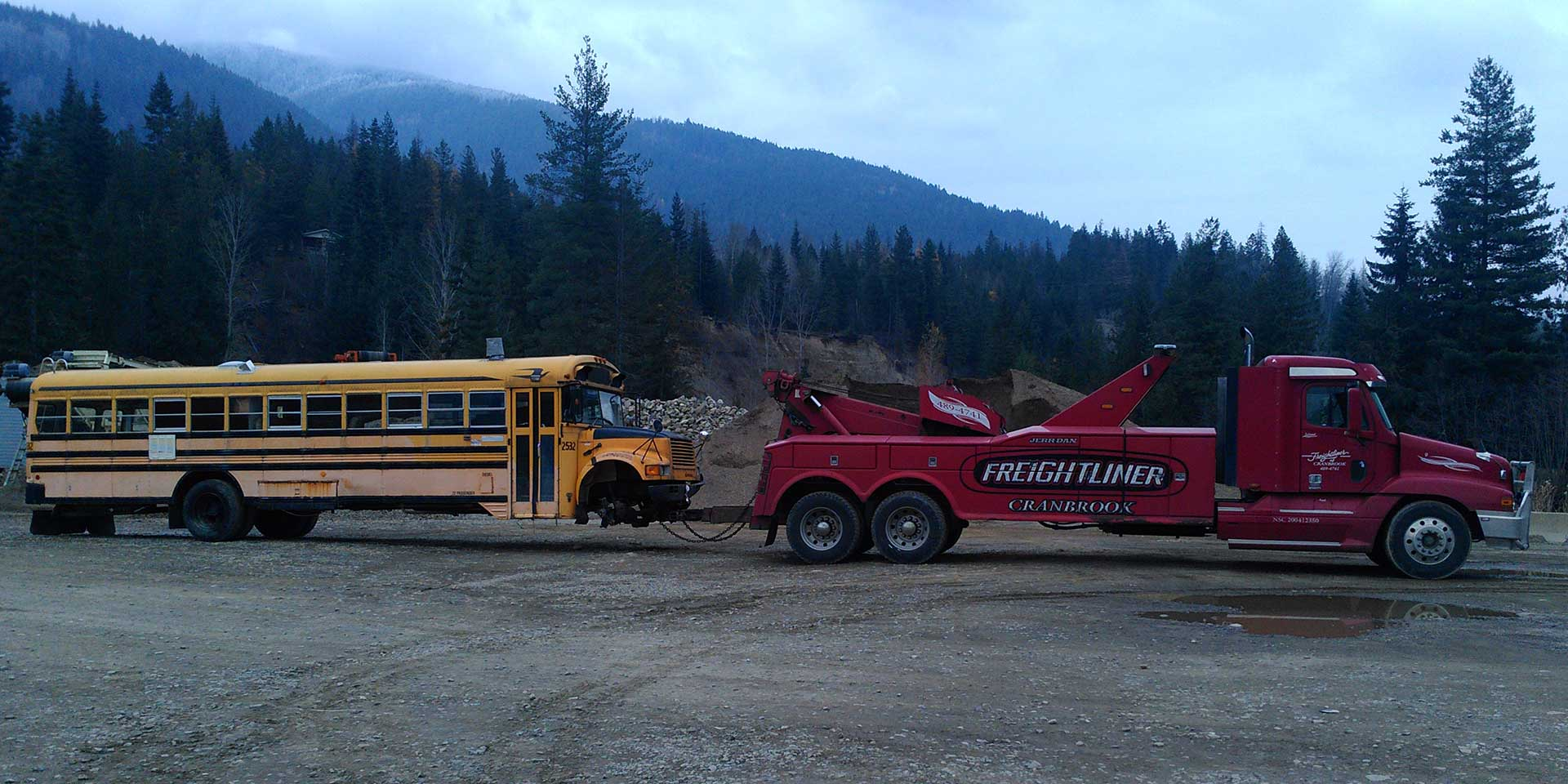 red truck towing school bus