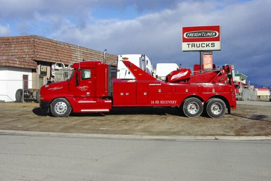 red towing and recovery truck