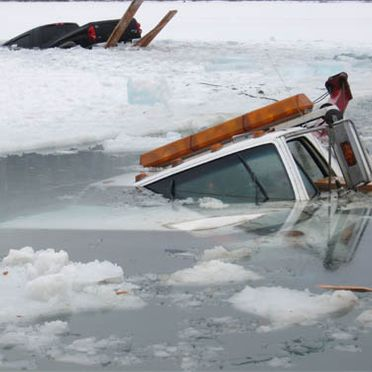 sinking vehicle in ice water