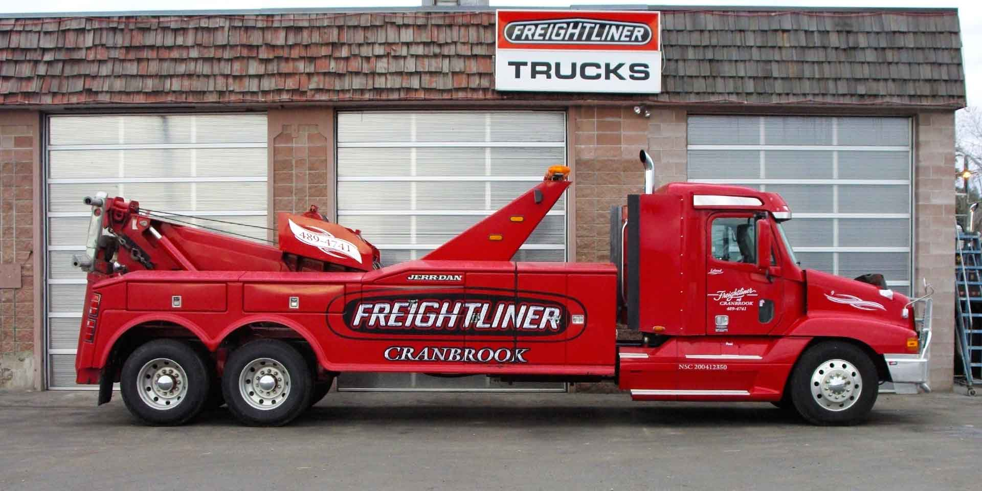 freightliner of cranbrook towing truck in front of shop